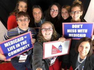 Group of LEND Trainees and faculty at the Disability Policy Seminar in Washington, D.C. holding up signs that say